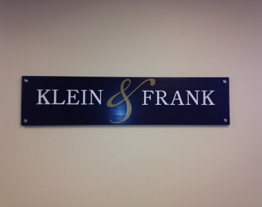 Custom wood and acrylic lobby sign